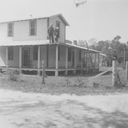 This photograph most likely shows Samuel Jay Griffin and Helen Griffin Horton Adams. The house is at 1891 Wacassassa St.